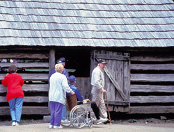 Visitors touring historic structure in park