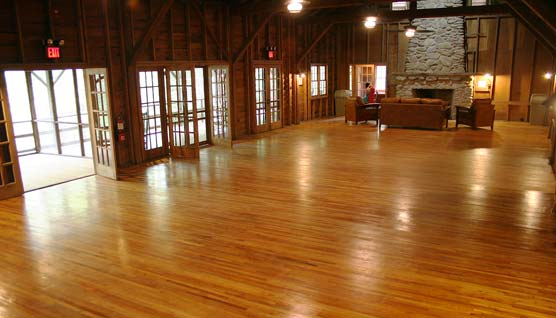 Interior view of the Appalachian Clubhouse with wooden floors, french doors and fireplace