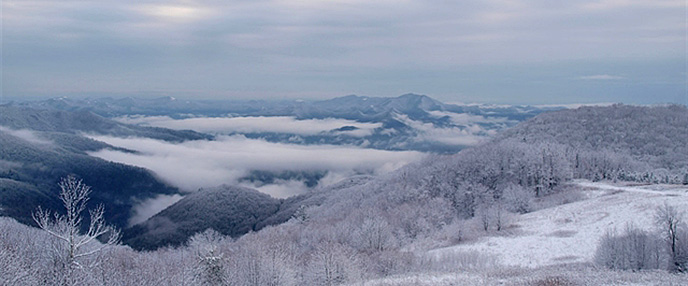 Fog fills the mountain valleys below Purchase Knob after a snowstorm.