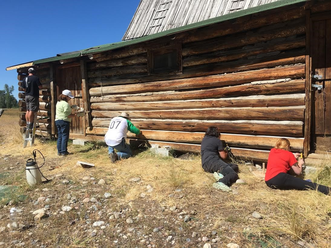 Hammer Corps volunteers work on a historic structure