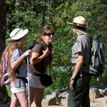 Interpretive ranger with park visitors