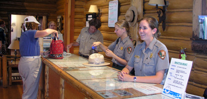Jenny Lake Visitor Center Naturalists at information desk.