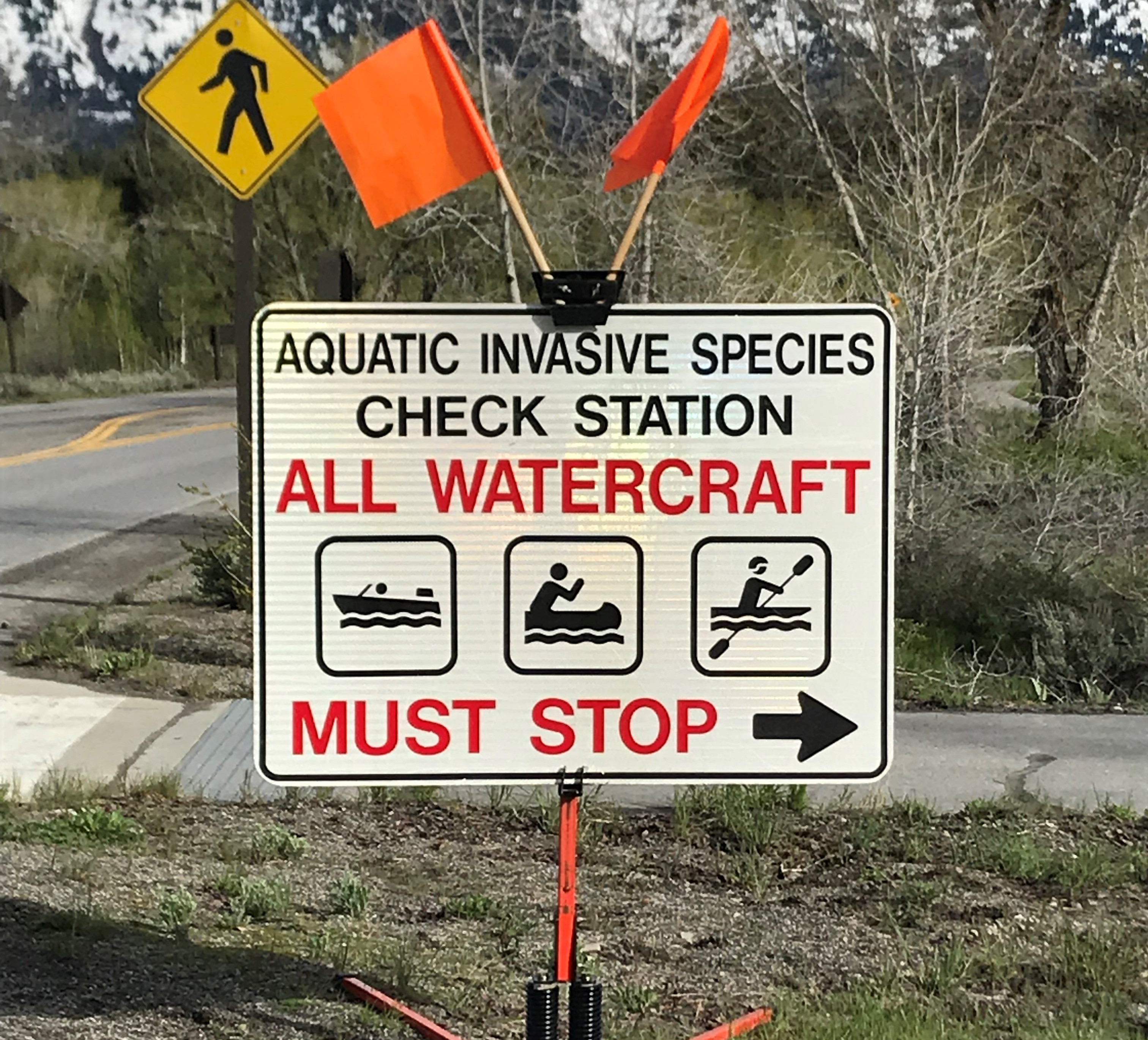 Photo of the park sign for the aquatic invasives check in station.