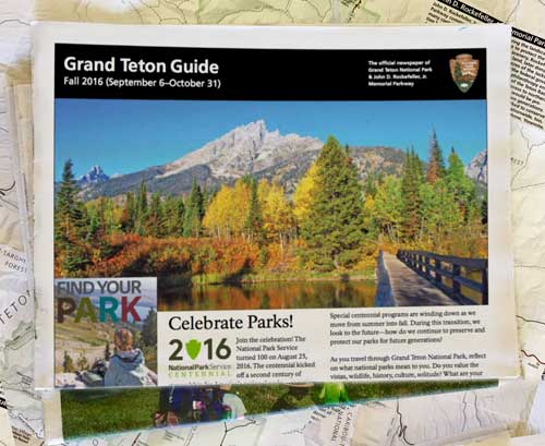 Grand Teton Guide sitting on top of a map