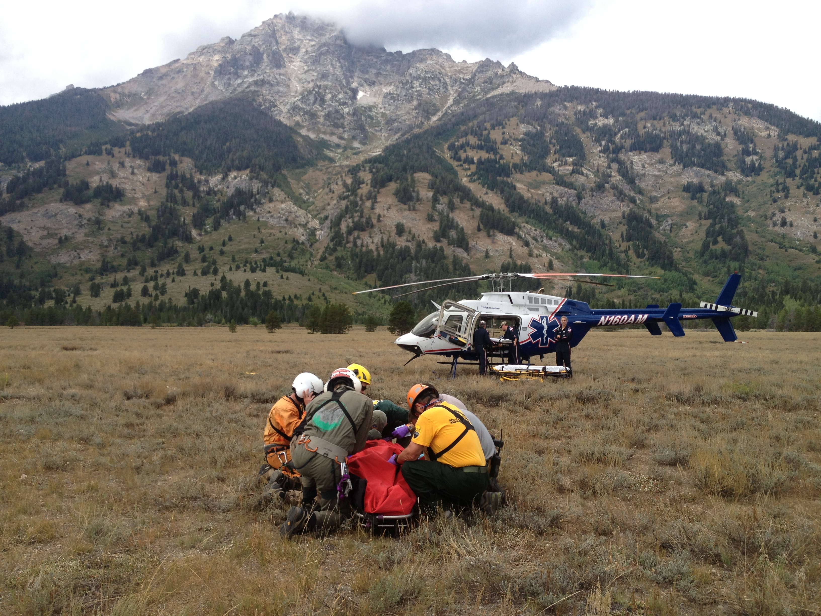 Park Rangers attend to White before loading him into a lifeflight helicopter