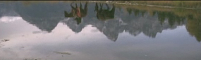 Snapshot of the Video River film, showing reflection of mountain man walking beside the Snake River