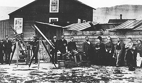 Black and white photo of a group of people with telescopes.