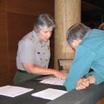 Visitor completing Lost & Found report with ranger