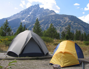 Two tents at Jenny Lake Campground with Teewinot in the background.