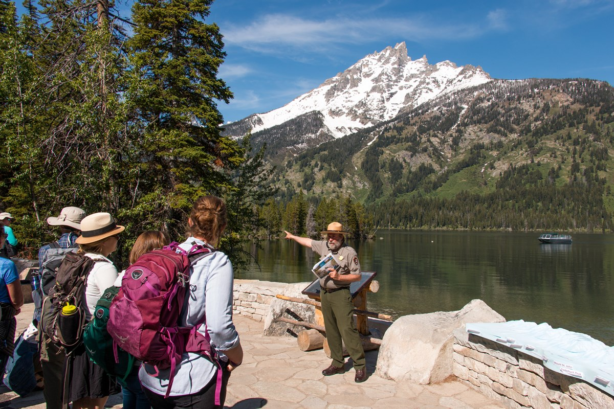 A park ranger provides visitors with information at Jenny Lake