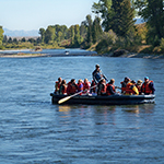 A group of people in a raft on the Snake River