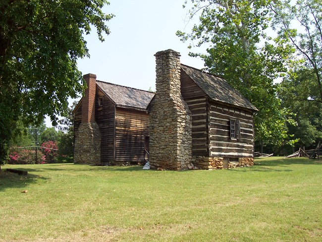 18th century southern colonial clapboard house and log kitchen