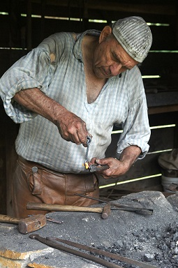 Blacksmith working in the foundry.