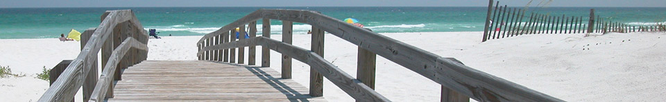 Beach walkway to white sandy beach and bluegreen waters