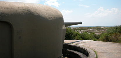 Massive steel housing protects a WWII 6-inch gun battery located in the Fort Pickens Area.