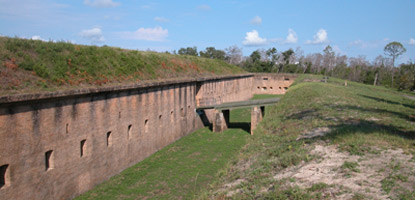 The drawbridge at Fort Barrancas crosses over a dry moat.