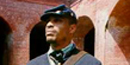 Murray Dorty, an African-American Union Civil War re-enactor, stands at attention inside Fort Massachusetts.