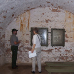 A ranger describes the significance of Fort Barrancas casemate to a park visitor.