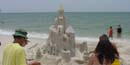 Visitors observe a sand castle on Perdido Key Beach in Florida.