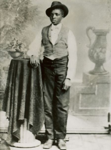 Black and white image on George Washington Carver as a teenager.