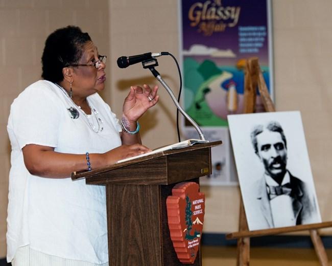 A women speaking at the podium during a Carver Day celebration.