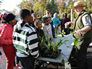 Ranger showing students how plants grow