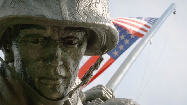 Closeup of statue with American flag