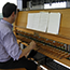 Guest artist at the carillon playing console, which resembles the keyboard of an organ