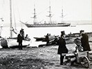 Men in top hats pose with boats near Alexandria's wharf