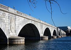 Arches of Memorial Bridge with bison head keystones and eagle-embellished supports