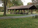 Wooden pavilion with picnic tables