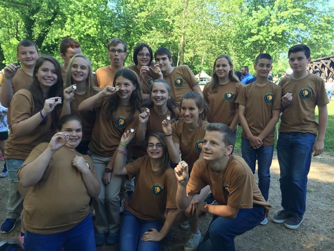 youth volunteers pose with Harpers Ferry quarters