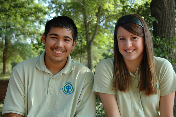 two youth conservation corps students pose for a photo