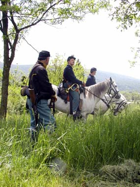 Cavalry volunteers prepare for a program on Bolivar Heights.