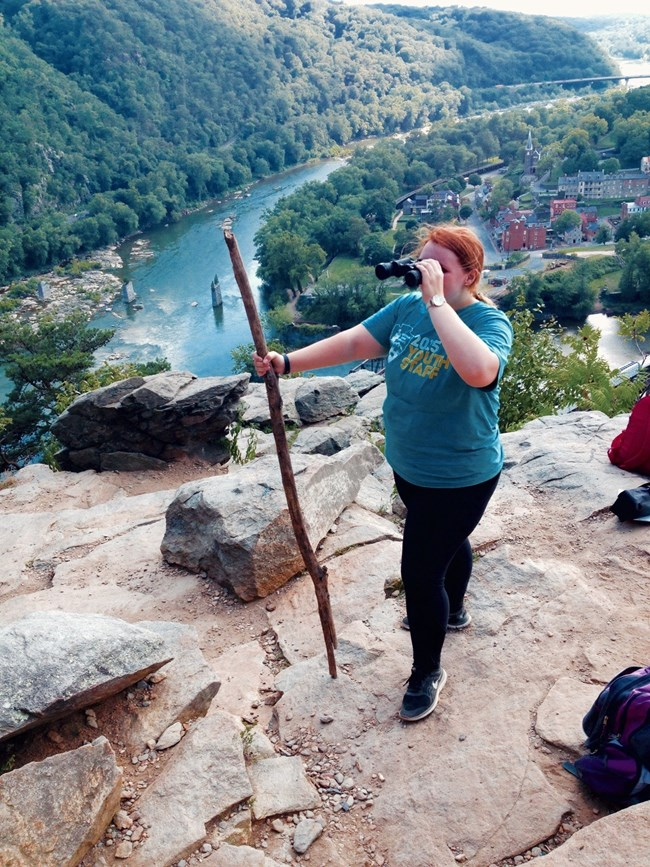 Intern Emily Griffith takes in the view at the Maryland Heights Overlook (NPS Photo, Zimmerman)