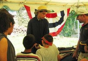 Neal King talks to visitors at the July 4th program