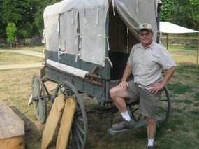 Jim Koenig stands in front of the wagon he repaired.