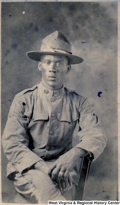 closeup photo of an African American man, seated, wearing his World War I uniform