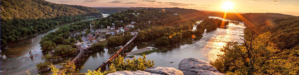 Sun beginning to set at Harpers Ferry, as seen from Maryland Heights. Photo by NPS Volunteer Buddy Secor.