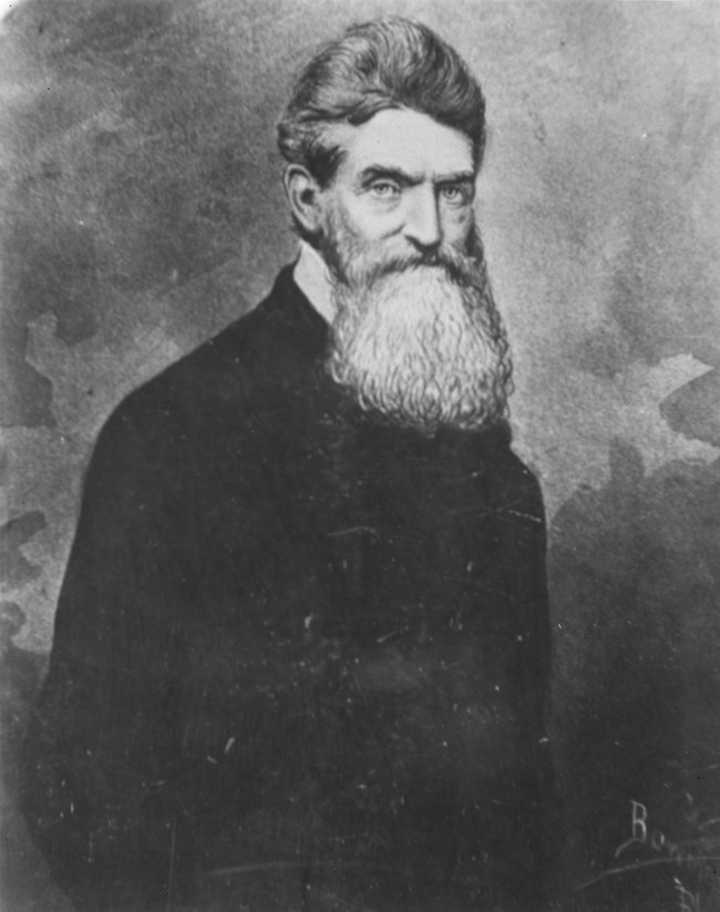 black and white image of John Brown; with a bread and black coat