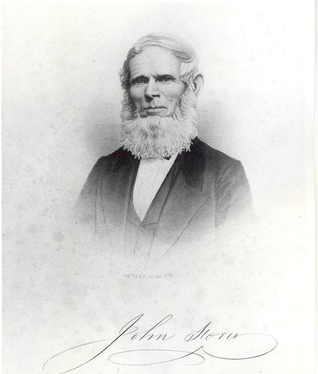 engraving of John Storer; white haired, bearded man wearing a suit; head and upper body image; his signature is at the bottom