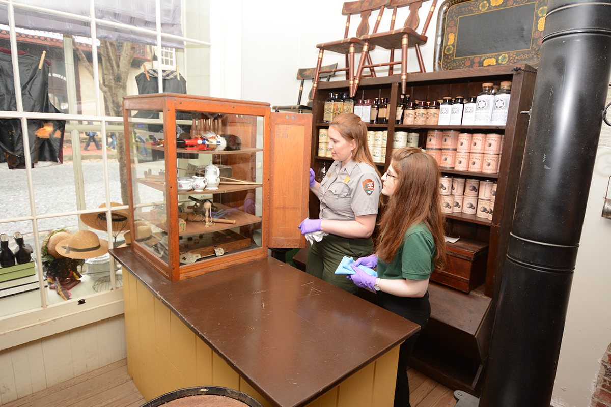 museum management staff cleaning the Dry Goods Store