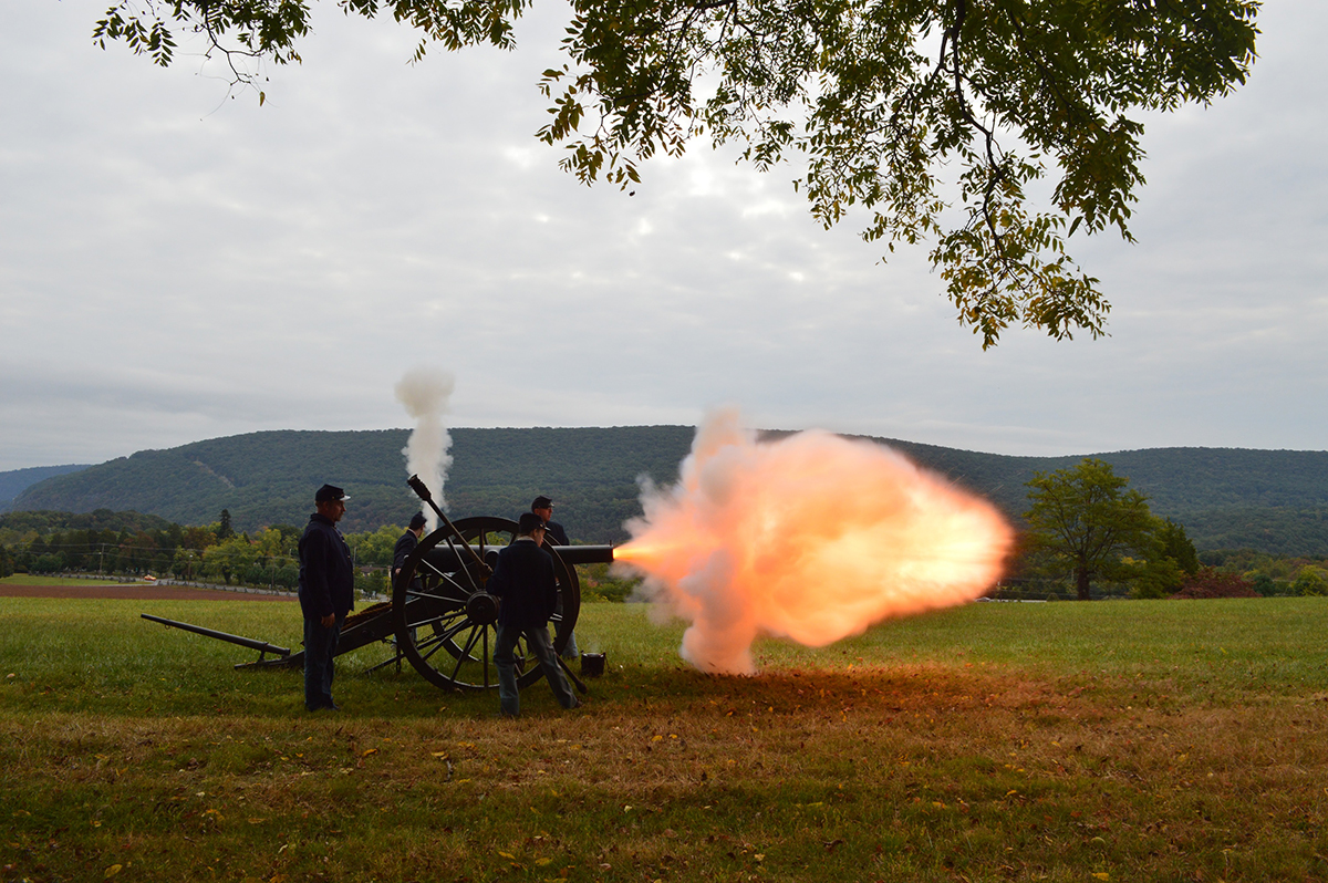 Artillery crew firing a cannon at Bolivar Heights Battlefield