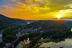 view of Harpers Ferry from Maryland Heights; at sunset, in the late summer