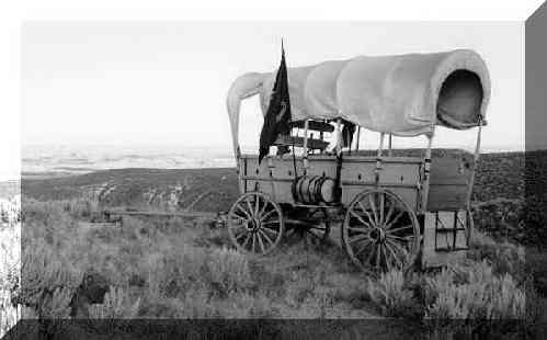 Covered wagon with the sides rolled up.