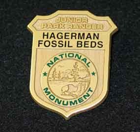 plastic Junior Ranger badge as given at park, says Hagerman Fossil Beds National Monument on it
