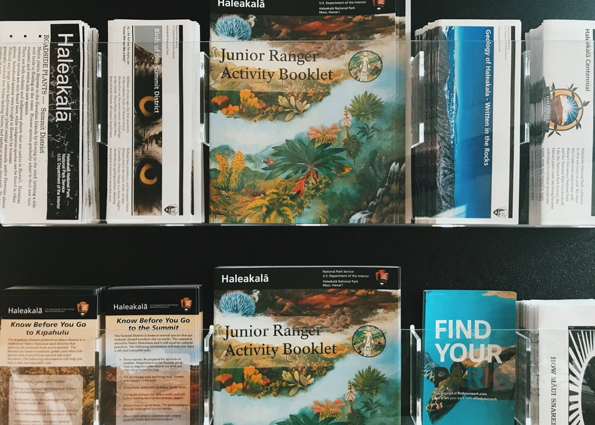 A rack of brochures available at the visitor centers.