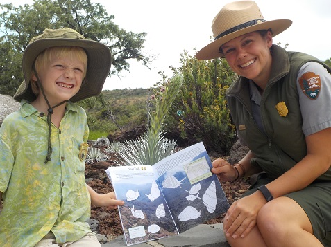 Eliot shows Ranger Katelyn his favorite activity in the book,