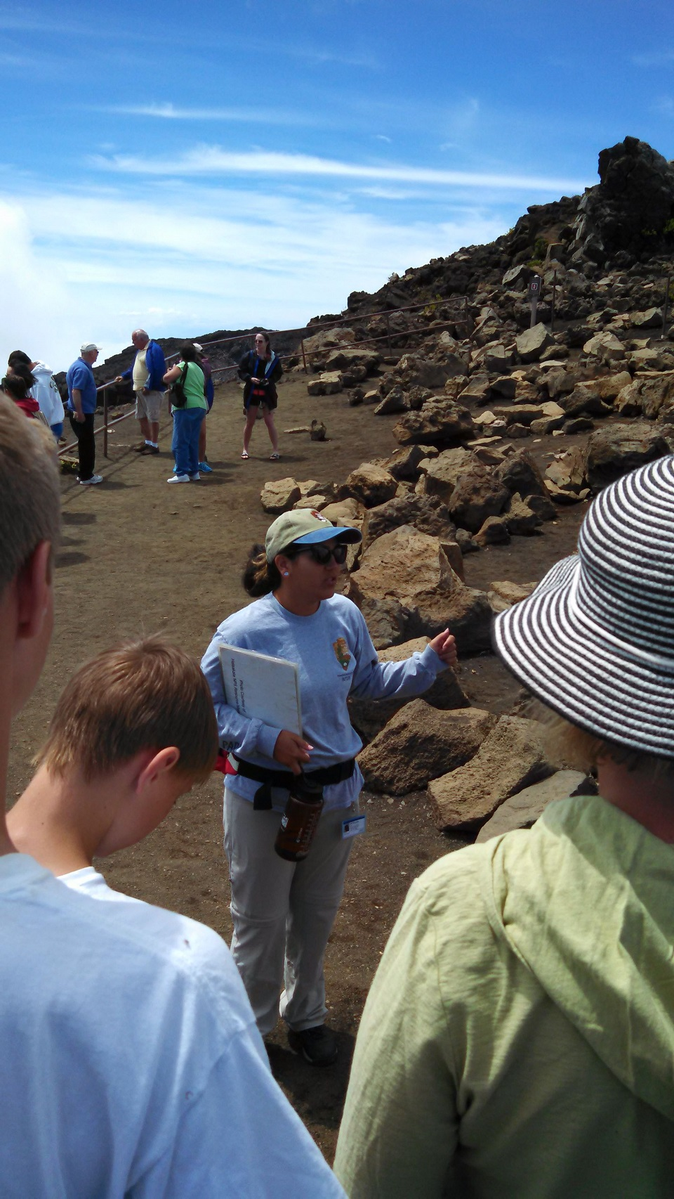 Former Visitor Services volunteer Emily Fernandes leads a walk by the crater overlook, at 9741 feet of elevation.