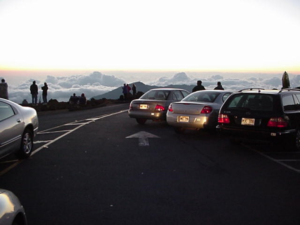 Cars block the traffic lane in the summit parking lot (10,023 feet of elevation).